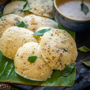 Rava Idli is South Indian breakfast dish made using semolina. Learn to make soft, hotel style idli at home using my recipe. Here is how to make it.