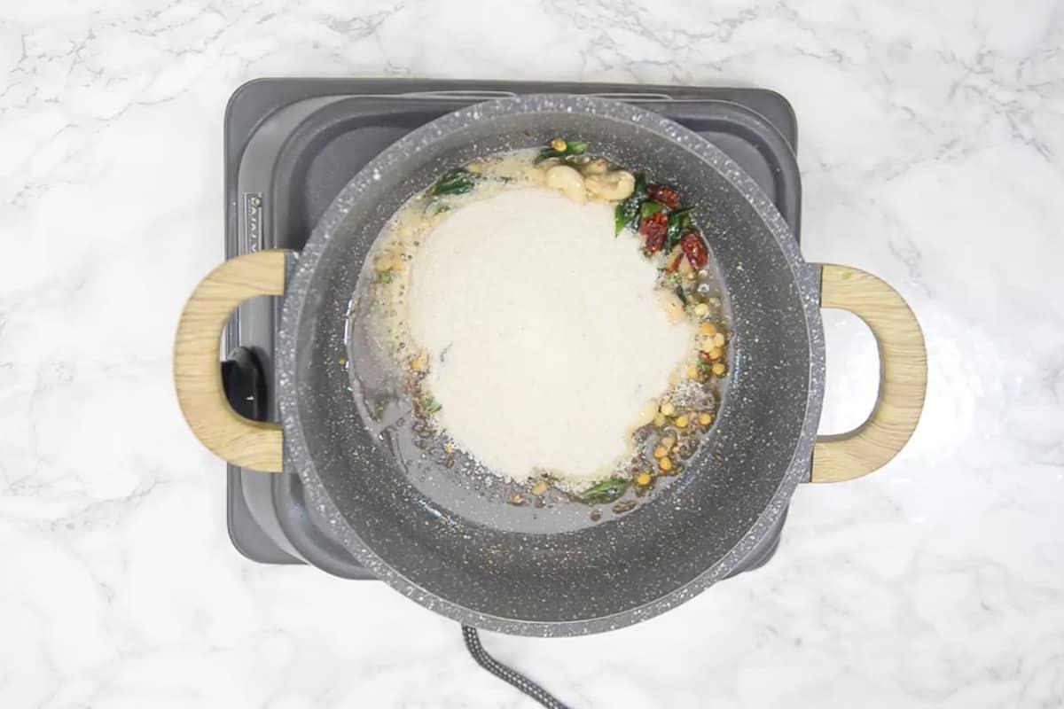 Semolina added in the pan.