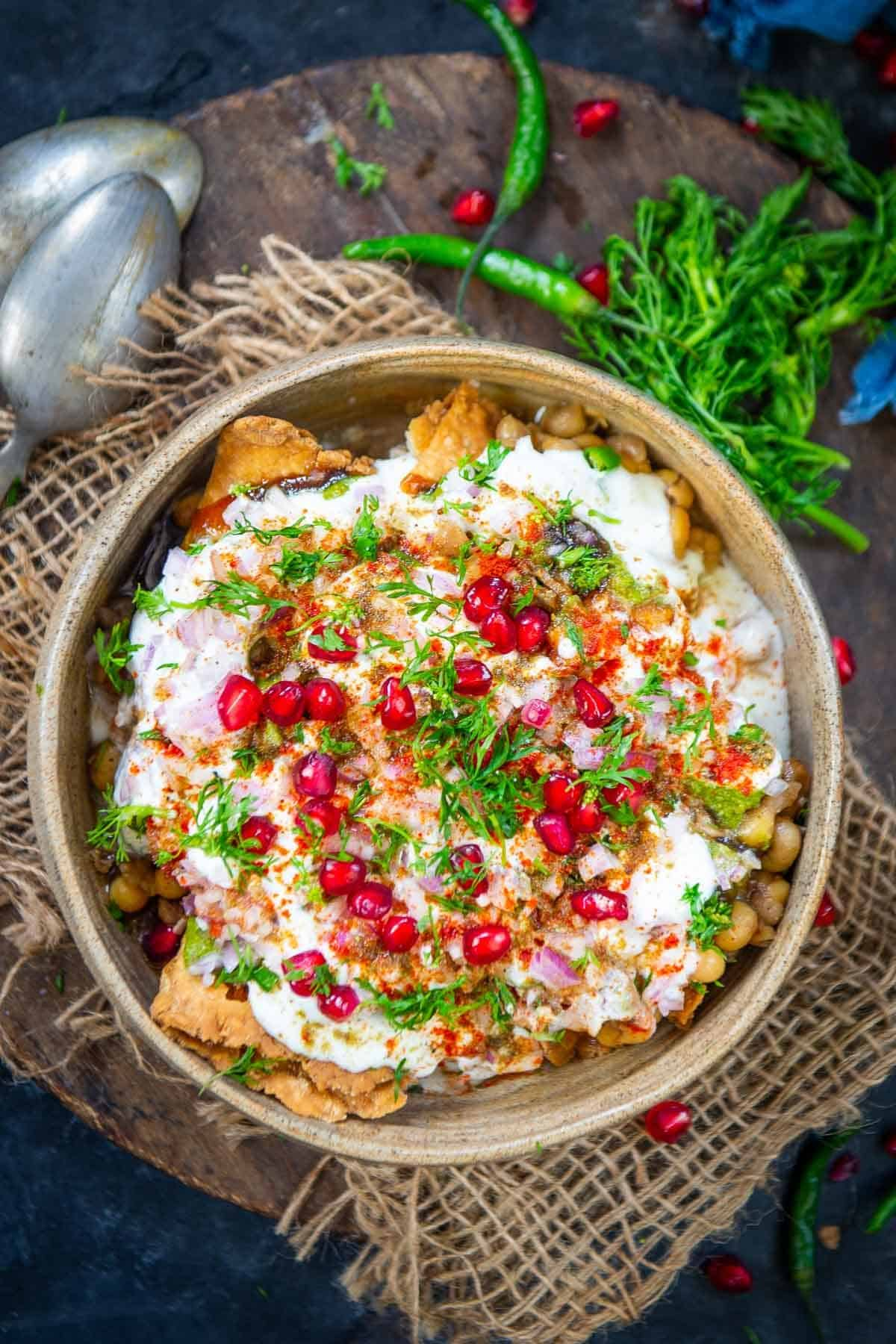 Samosa Chaat served on a plate.