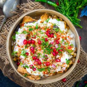 Samosa Chaat is a delicious Indian street food where crispy Punjabi samosa is topped with a tangy and spicy chutney mixture. Here is how to make Samosa Chaat Recipe.