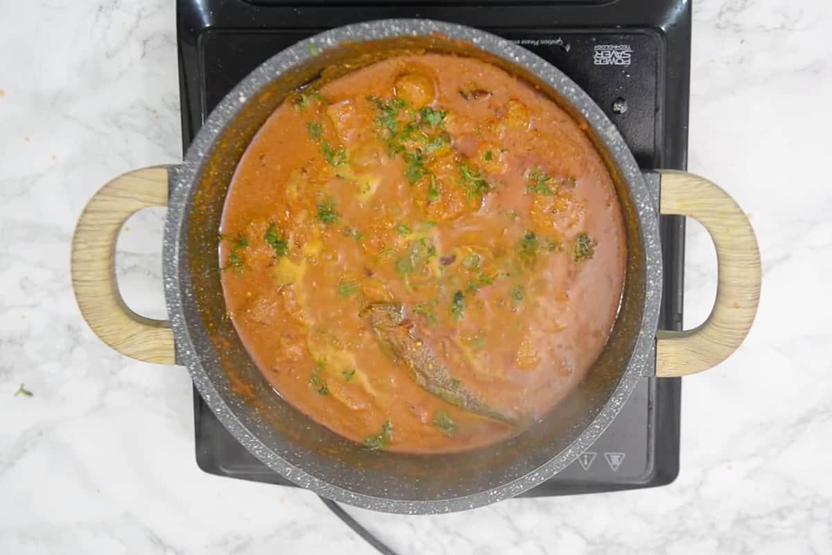 Ready soya chaap curry garnished with fresh coriander.