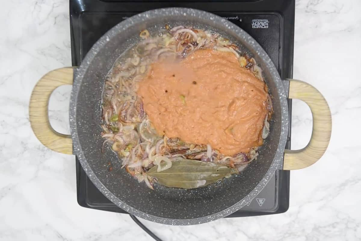 Tomato ginger garlic green chilli onion paste added in the pan.