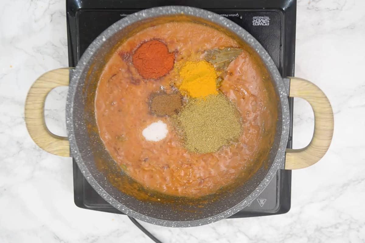 Coriander powder, turmeric powder, Kashmiri red chilli powder, roasted cumin powder and salt added in the pan.