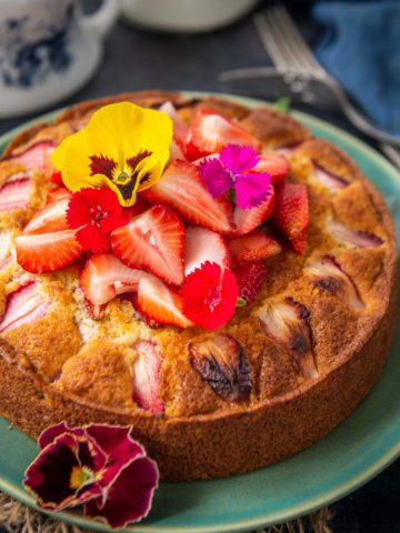 This old fashioned Strawberry Cake is a moist cake that is very simple to make. It has great crumbs and a slight tang from the fresh strawberries. Here is how to make it from scratch.