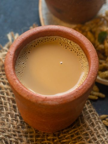 Tandoori Chai or Kulhad Chai is a delicious twist on the regular tea where Masala Chai is smoked by putting in a hot kulhad or clay mug. Here is how to make it at home.