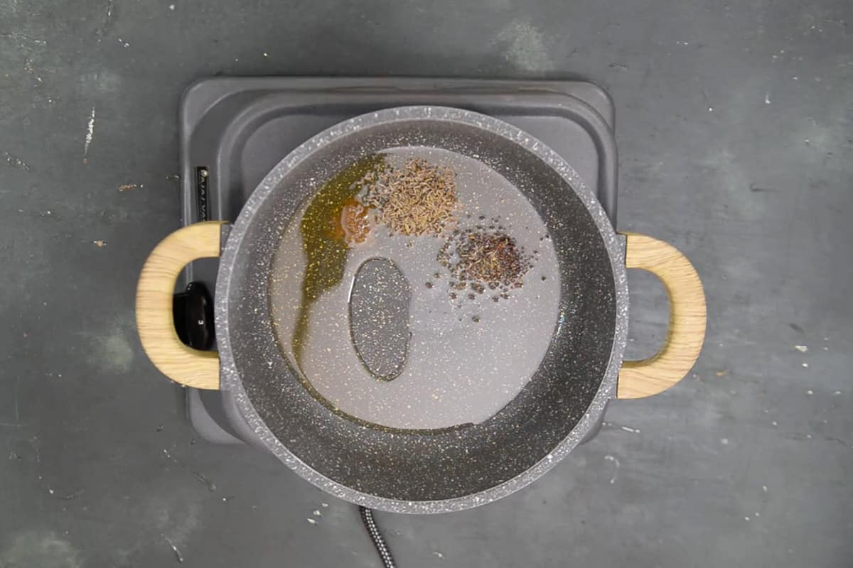 Hing, mustard seeds, and cumin powder added in hot oil.