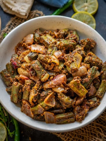 Rajasthani Besan Bhindi is a dry side dish of okra cooked with chickpea flour and spices. This North Indian besan wali bhindi is easy to make and tastes delicious. Here is how to make it.