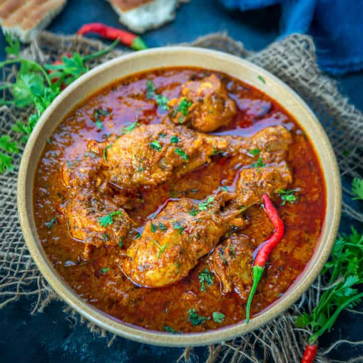 Restaurant Style Chicken Angara is a spicy chicken curry made using freshly ground masala powder. Check out its recipe here!