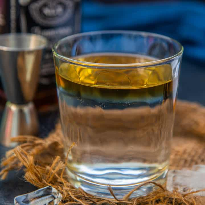 Dalgona Whiskey or Dalgona Peg is the new style of serving whiskey where it floats over water instead of getting mixed with it. Here is how to make it.
