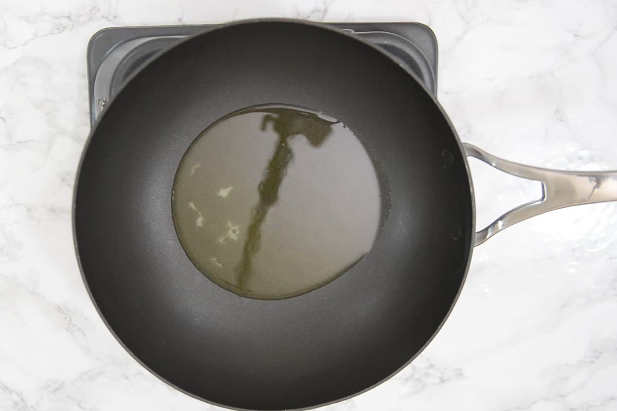 Ghee and oil heating in a pan.