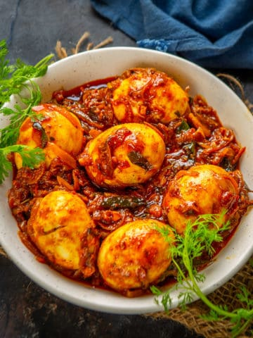 Kerala Egg Curry or Mutta Curry is a spicy egg curry made in Kerala style. It can be made with or without coconut milk. Serve it with Appam or Rice for a hearty meal. Here is how to make it.