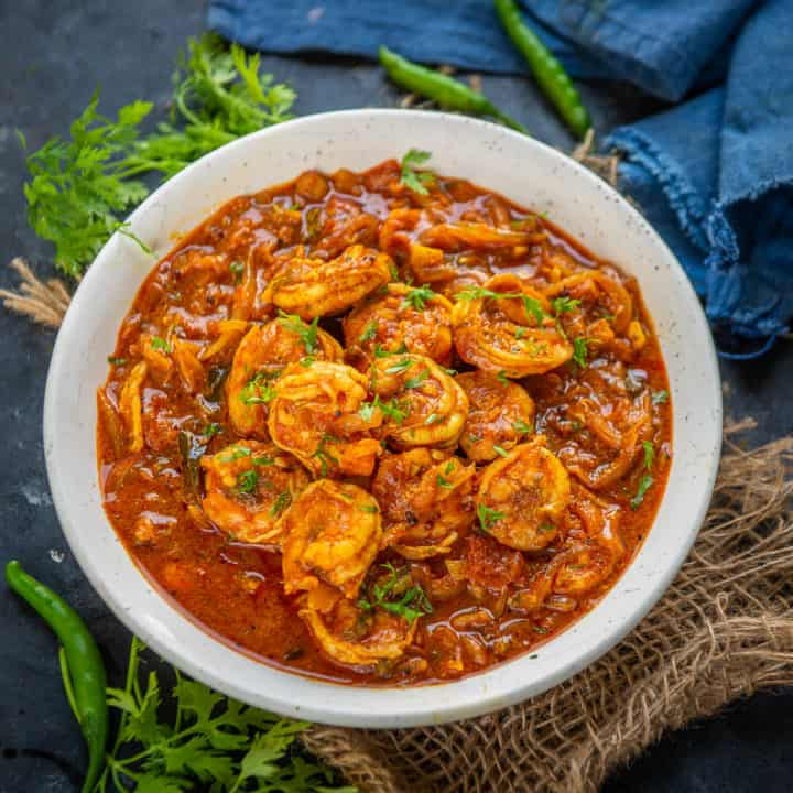 Kerala Prawn Curry or Chemmeen Curry is a spicy shrimp curry made in traditional Kerala style. Here is how to make it.