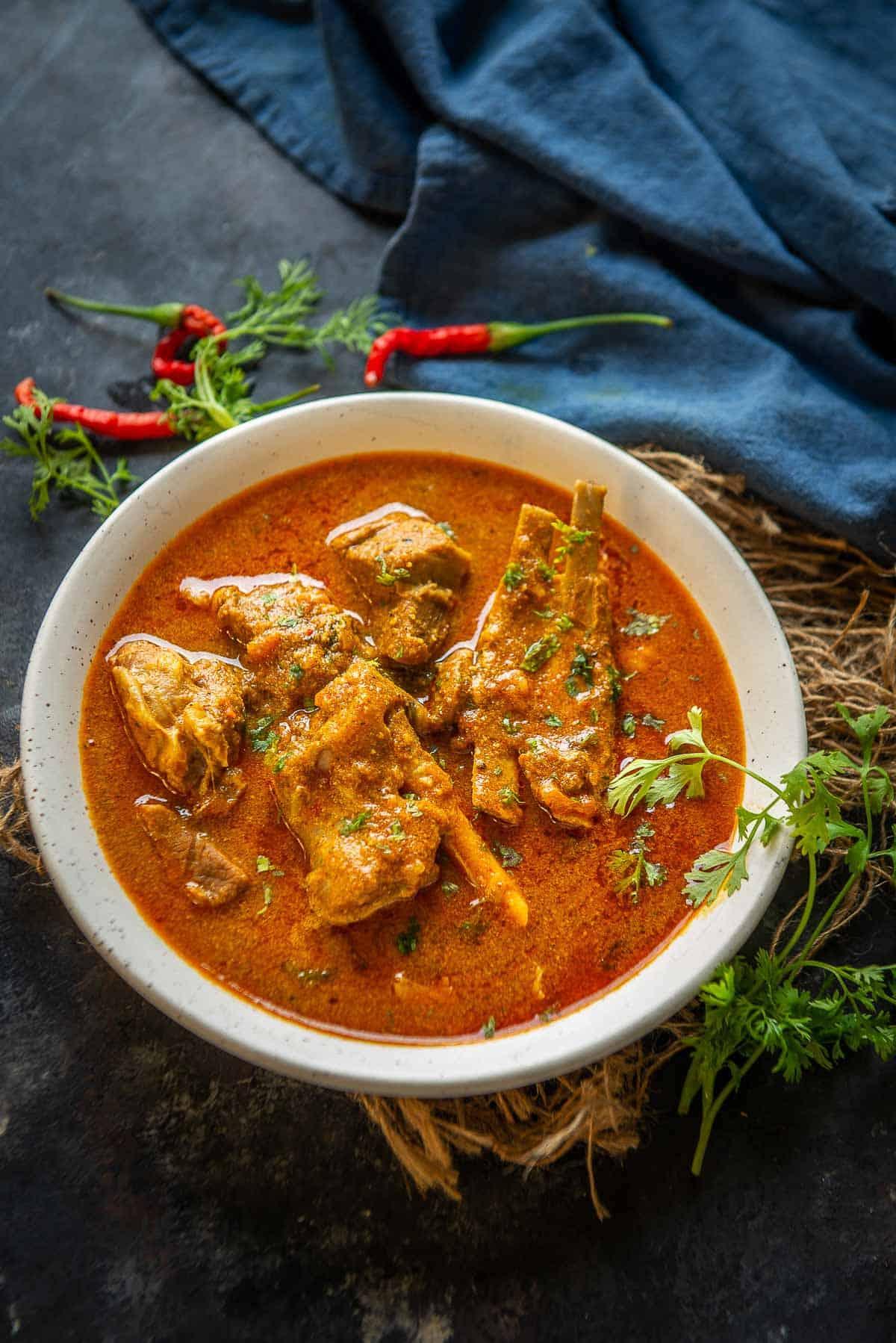 Mutton Kulambu served in a bowl.