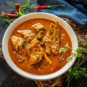Mutton Kulambu is a spicy village-style mutton curry that is popular in the Chettinad region of India. This easy to make curry tastes great with rice. Here is how to make it.