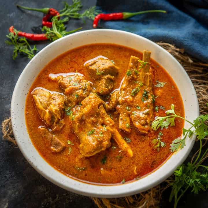 Mutton Kulambu is a spicy village style mutton curry which is popular in the Chettinad region of India. This easy to make curry tastes great with rice. Here is how to make it.
