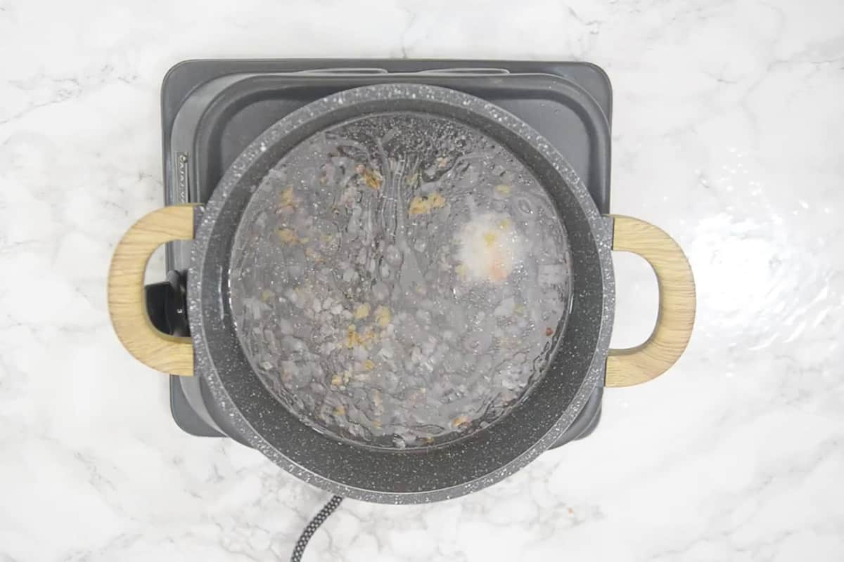 water and salt added in the pan.