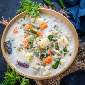 Vegetable Stew is a Kerala Style veg curry where veggies are cooked in coconut milk and very mild spices. It goes great with appam and rice. Here is how to make it.
