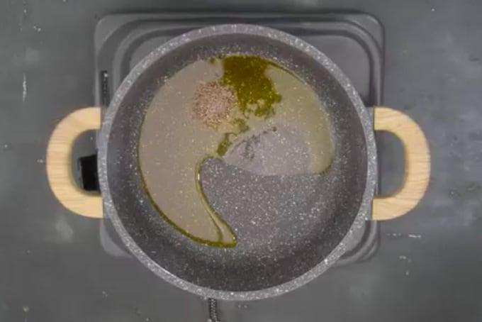 Cumin seeds added in hot oil.