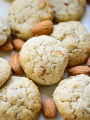 Buttery, crunchy, chewy, all at the same time, these Almond Cookies are the perfect bake for Christmas. These melt in your mouth cookies come together in under 30 minutes using basic pantry staples. Here is how to make it.