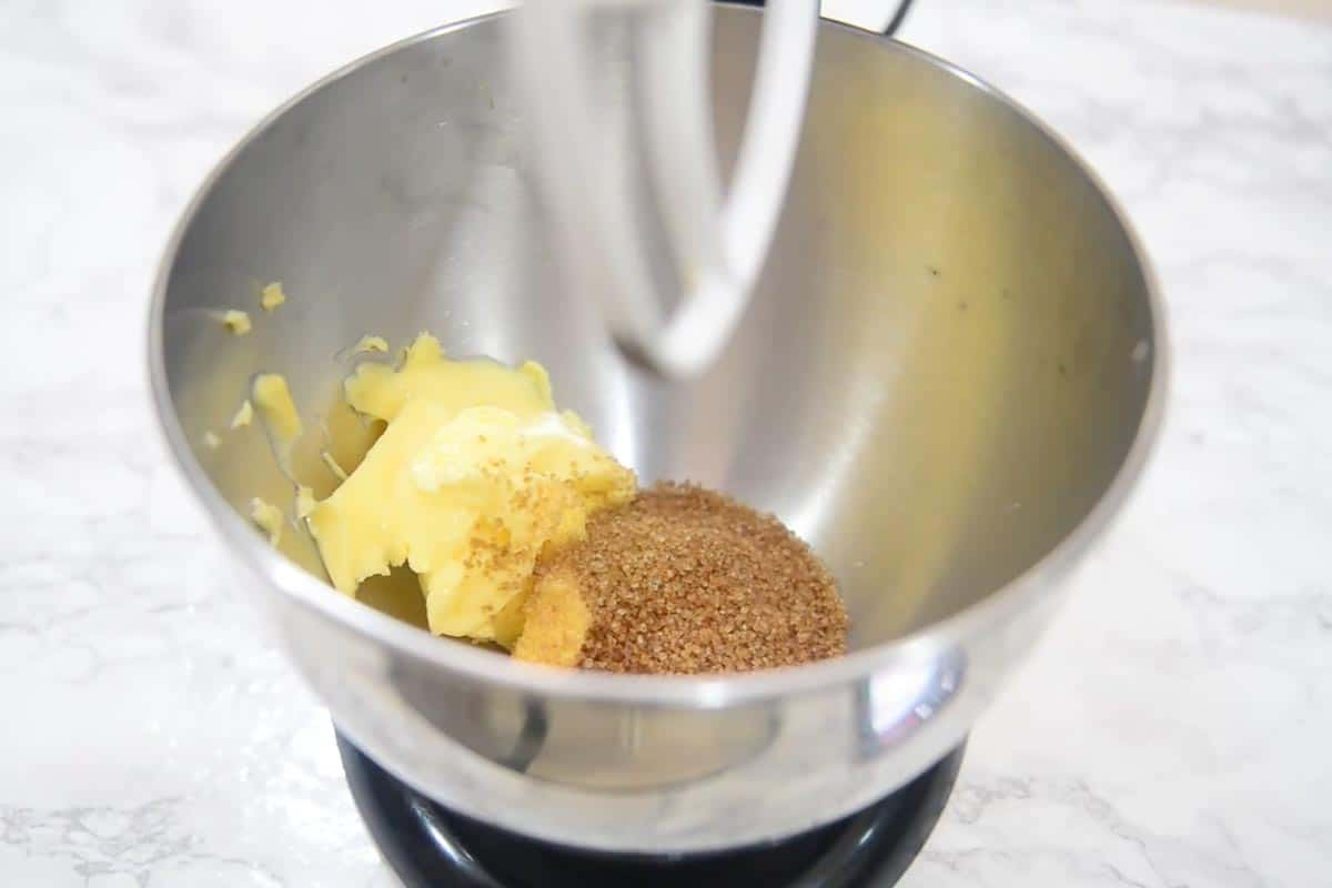 Butter and sugar whisked in an electric mixer.