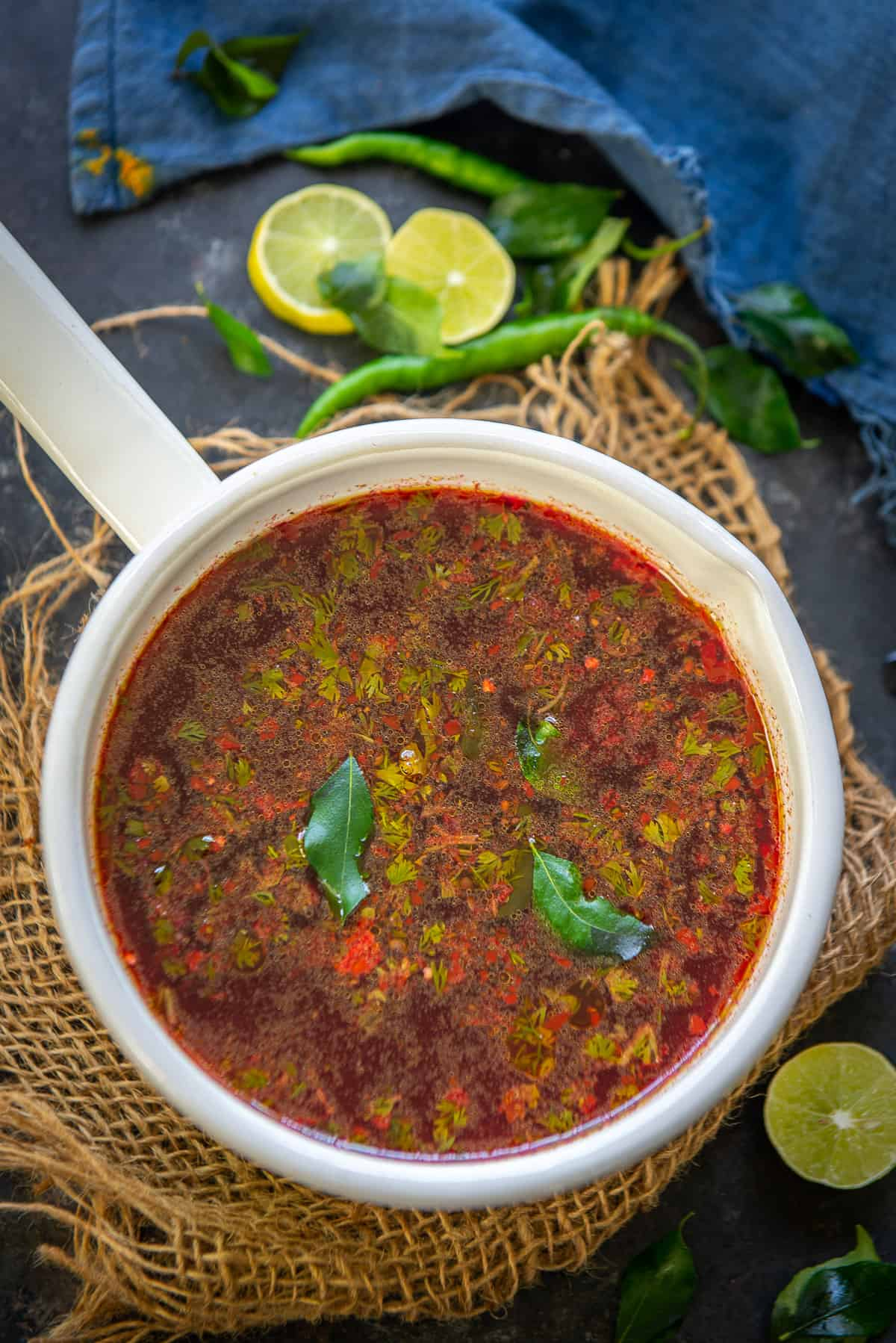 Beetroot Rasam served in a pan.