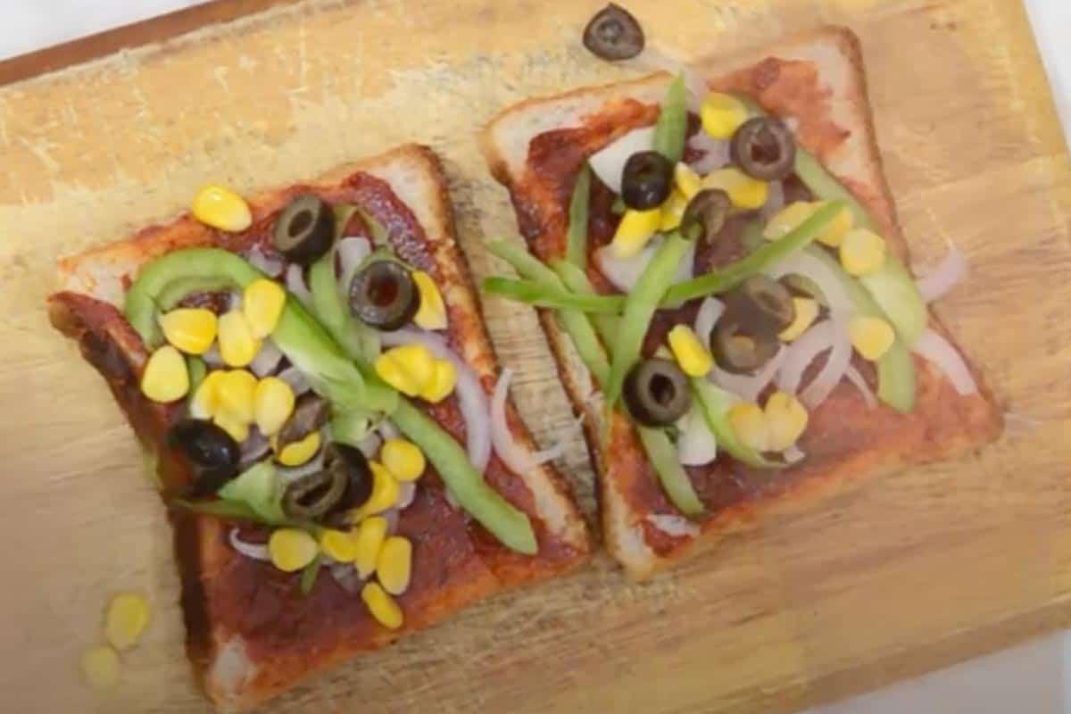 Topped with onion, capsicum, corn and olives.