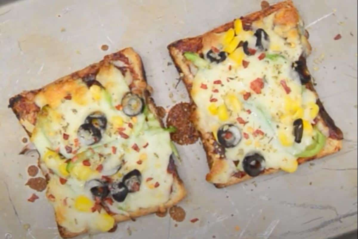 Ready Bread Pizza garnished with chilli flakes and oregano.