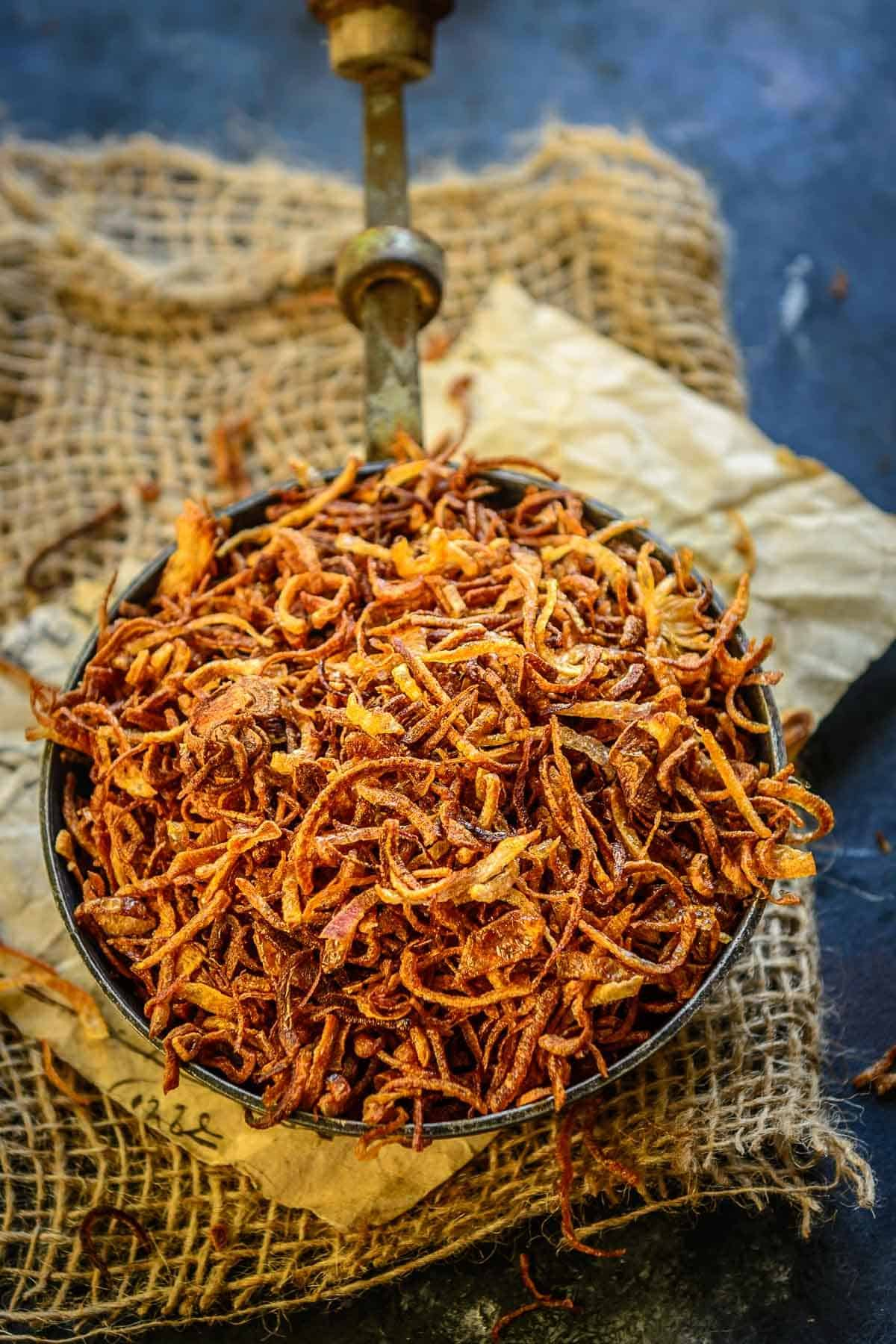 Fried onions kept in a bowl.