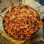 Fried Onions or Birista are thin onion slices deep-fried in oil till golden brown and crisp. Use these golden fried onions for making biryani, soups, dals, sandwiches, or sprinkle them over Khichdi or Matar Pulao for delicious flavor enhancement.