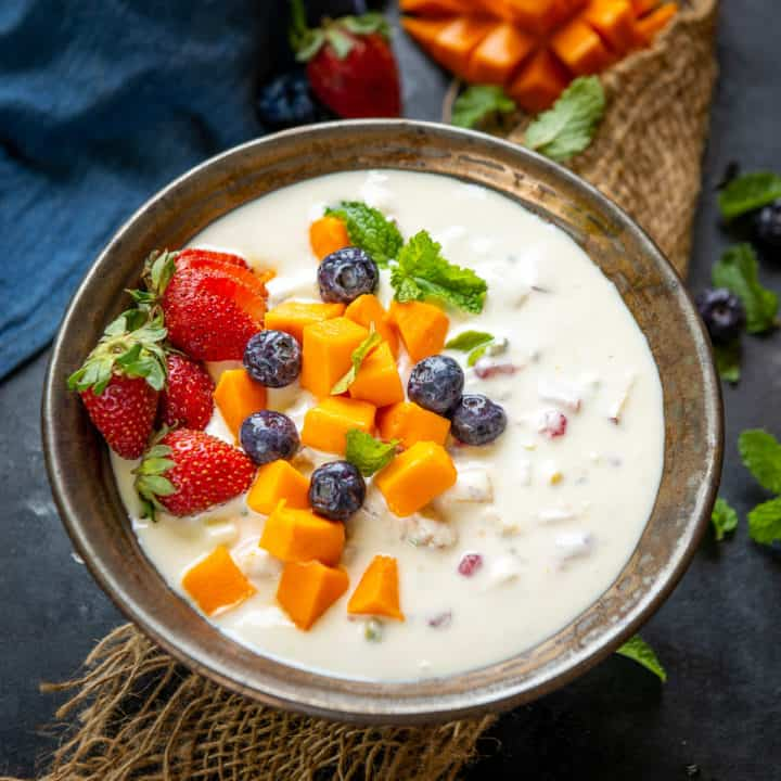 Fruit Cream is an Indian dessert where mix fresh fruits are added in a creamy base. Here is how to make it.