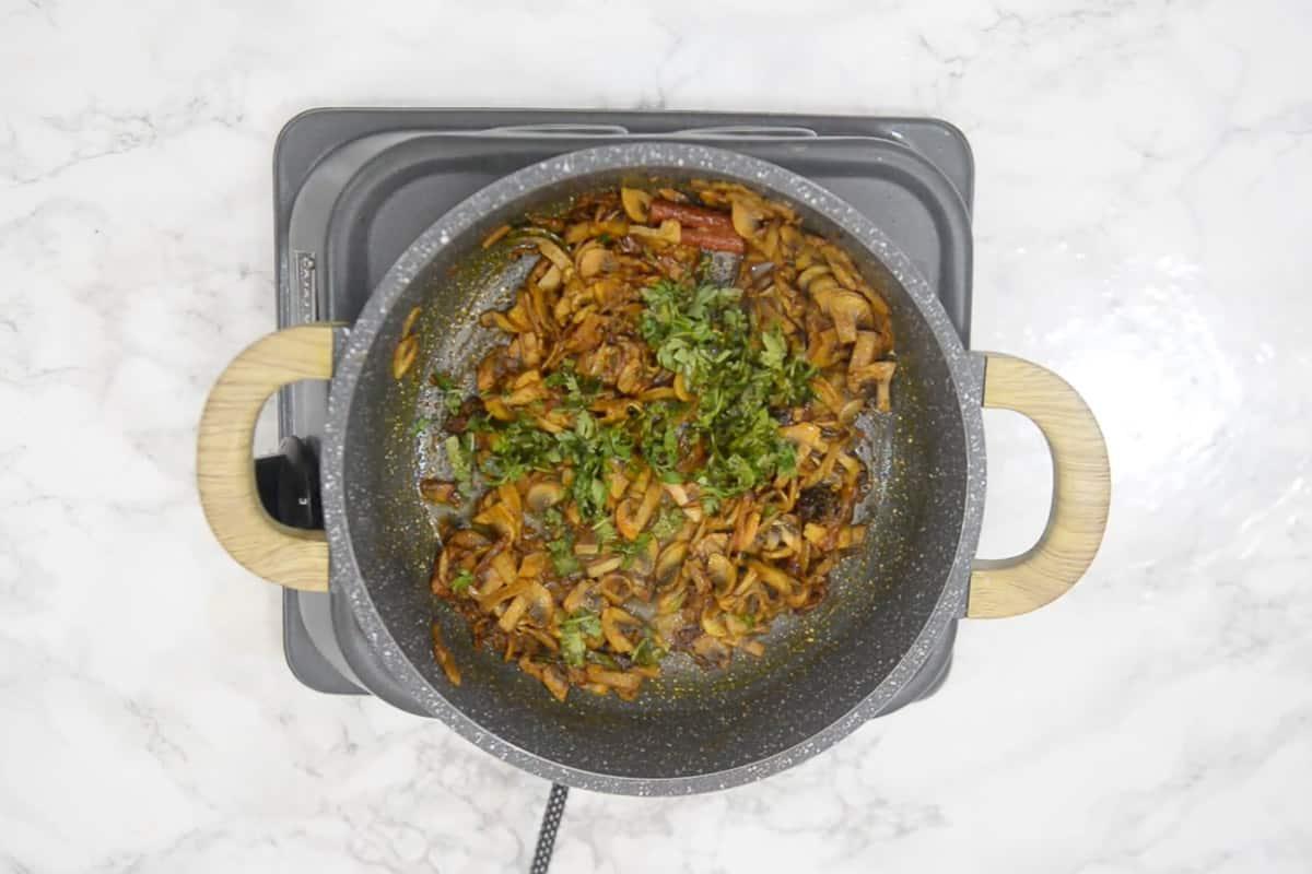 Coriander added in ready mushroom masala.
