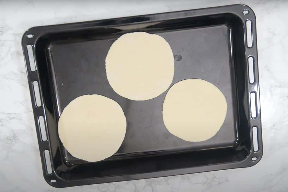Rolled dough set on an oven tray