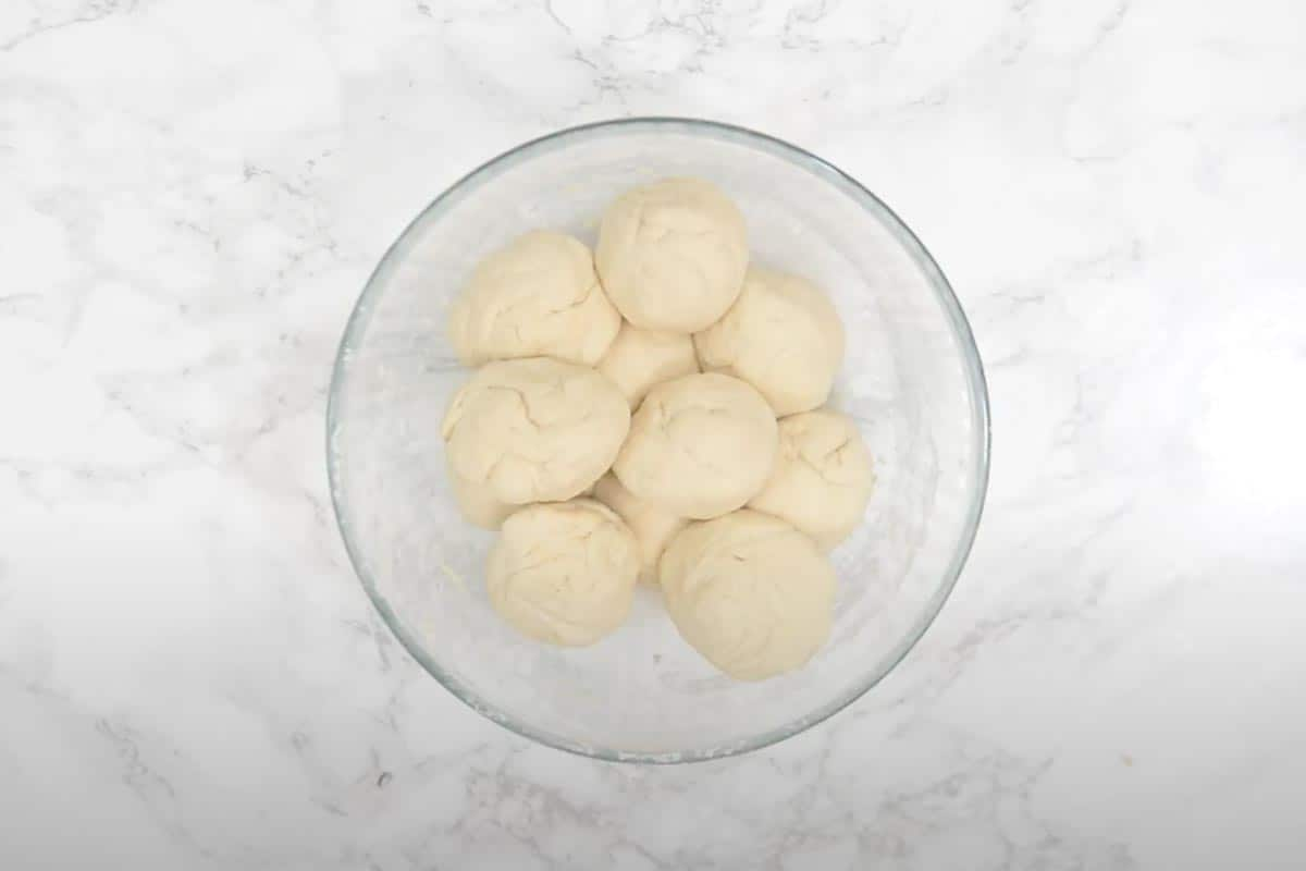Dough divided into equal sized balls