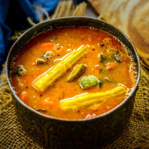 Tangy and Spicy Sambar is a South Indian staple dish that is served for all the meals including breakfast, lunch, and dinner. It is a stew of yellow lentils with vegetables and spices added to it. Here is my easy recipe to make it at home.