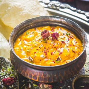 Aamras is a delicious Indian dessert made using ripe mangoes, milk, sugar, and ground cardamom. Serve it on its own as a dessert or with puffed puri for a hearty meal.