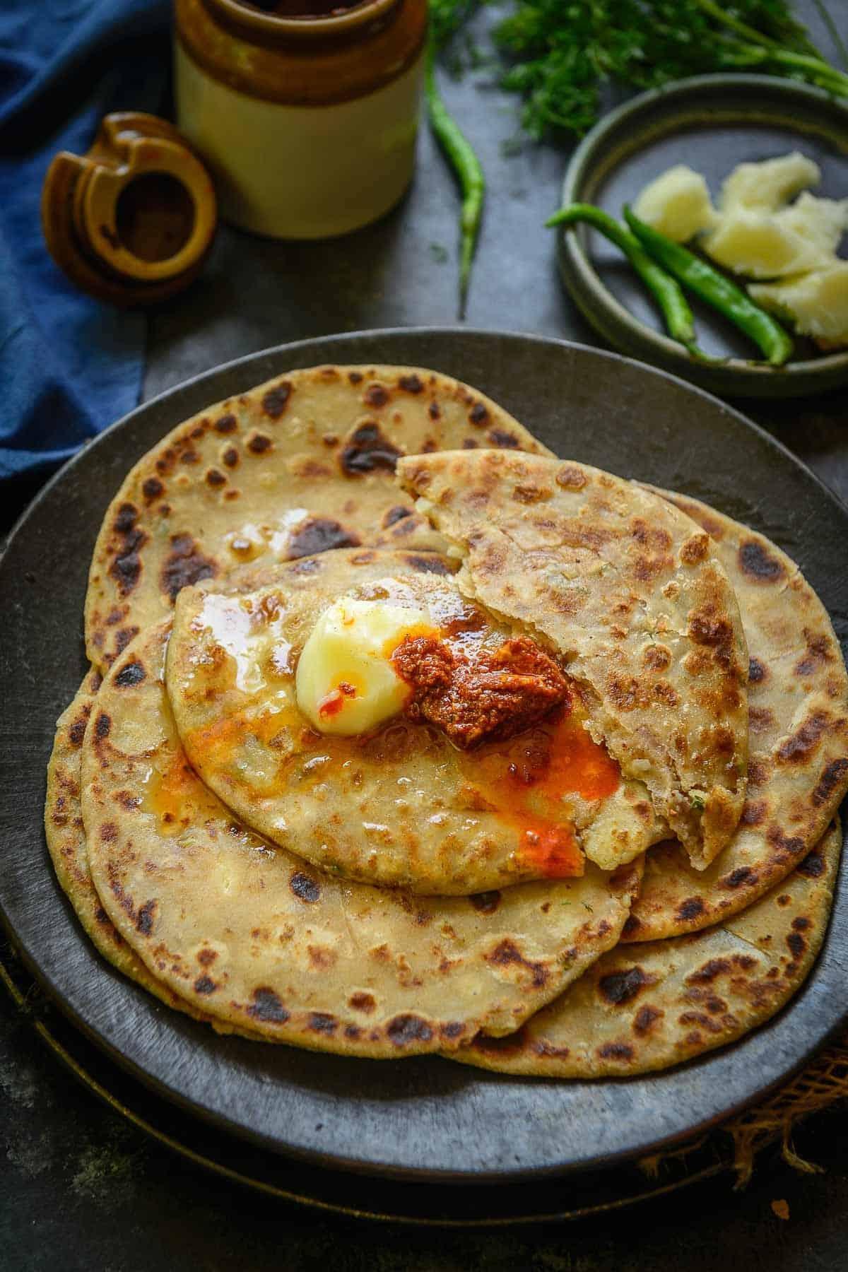 Aloo paratha served on a plate.