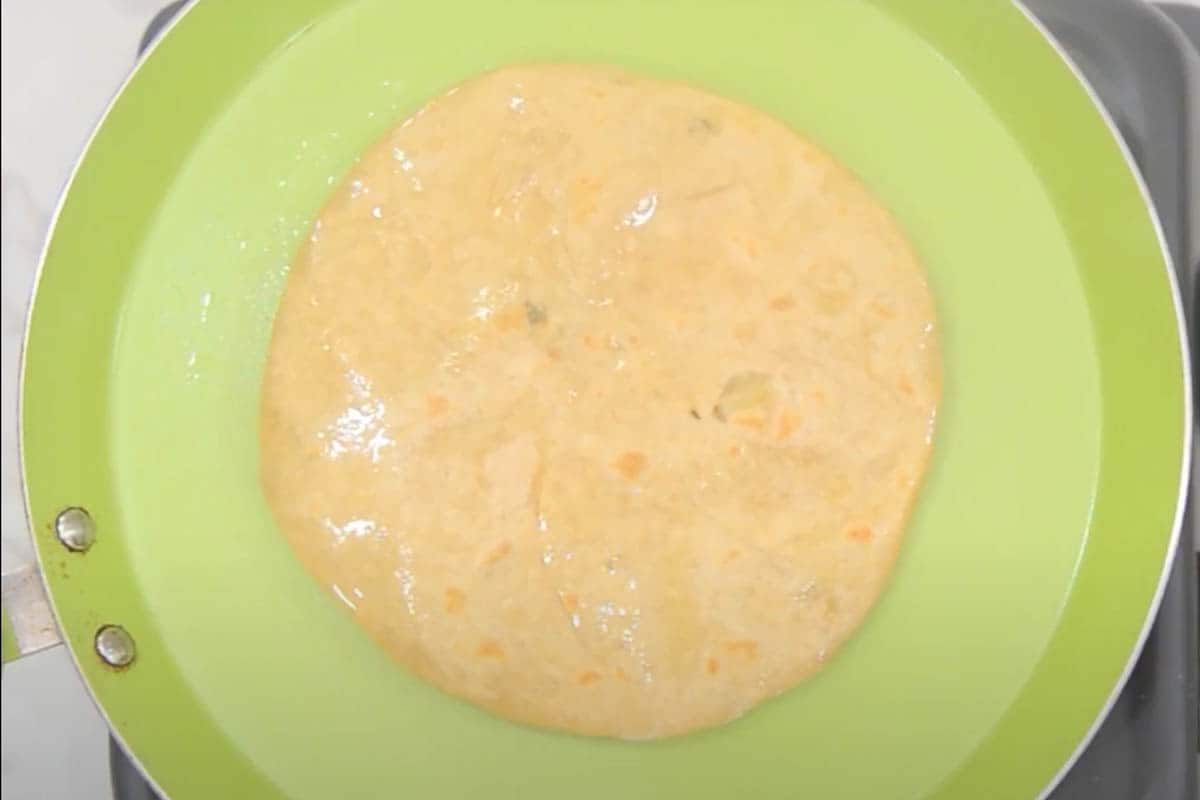 Ghee applied on the paratha.
