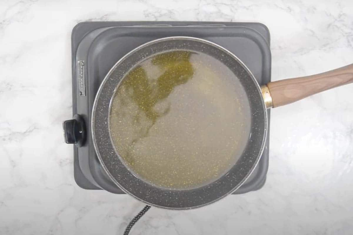 Oil for frying heating in a pan.