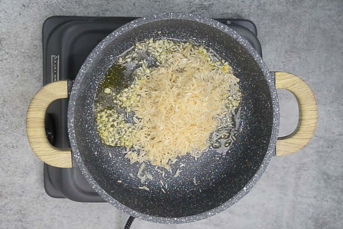 Rice added to the pot.