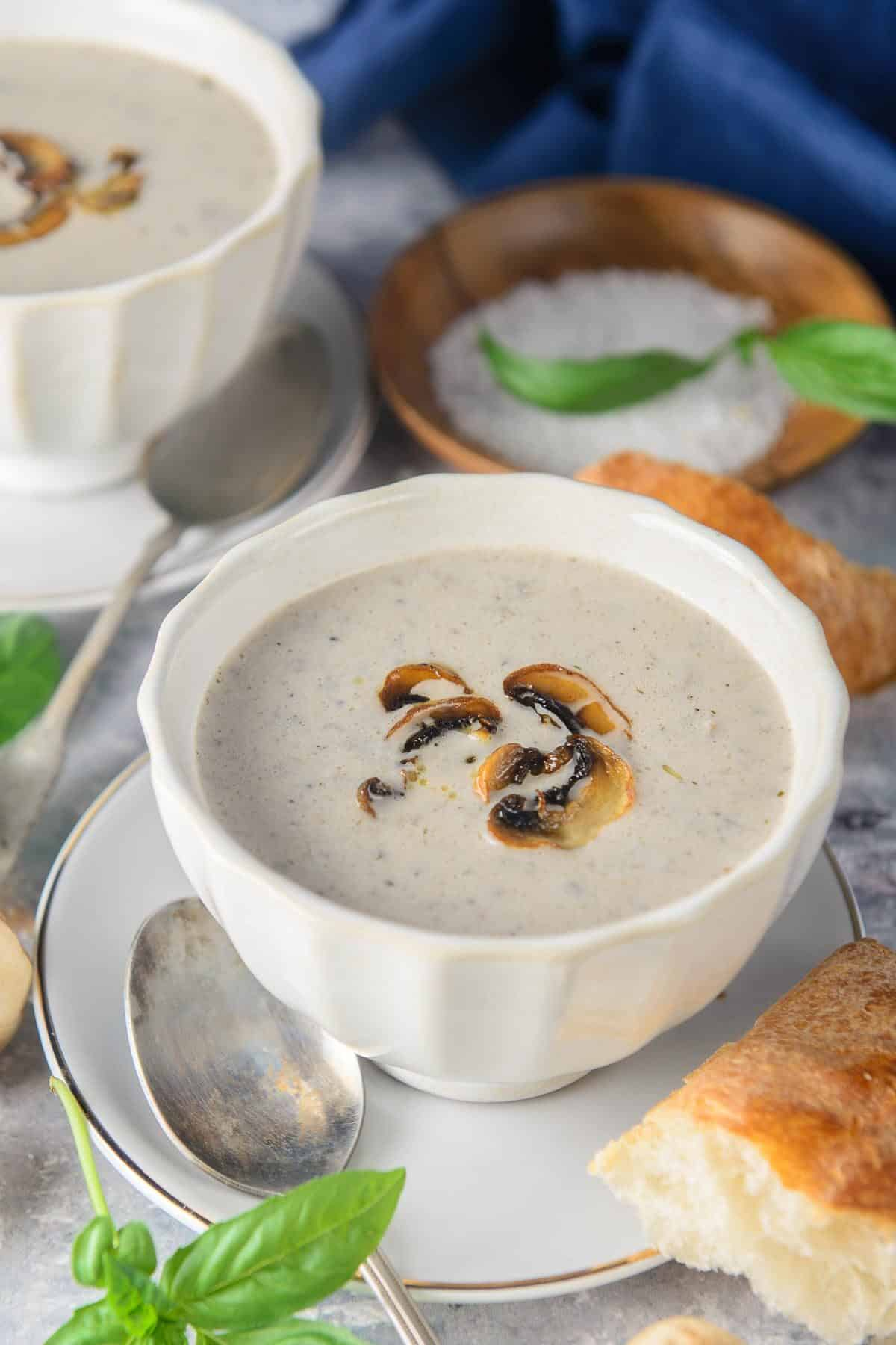 Homemade cream of mushroom soup served in a bowl.
