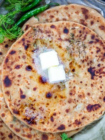 Gobi Paratha or Cauliflower Paratha is an Indian flatbread stuffed with a spicy cauliflower filling. It is a great dish to serve for any meal and it also works well for the lunch boxes. Here is how to make it.