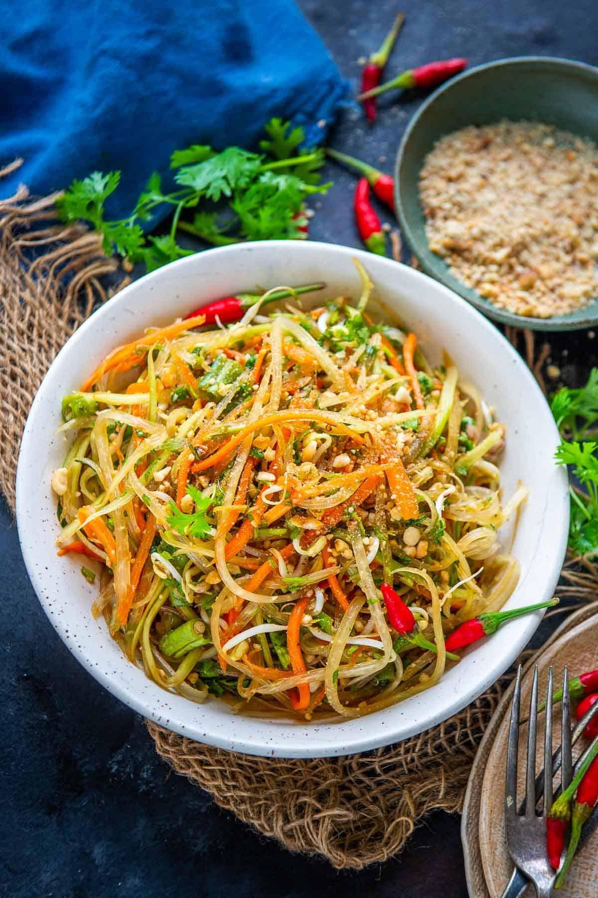 Green papaya salad served in a bowl.