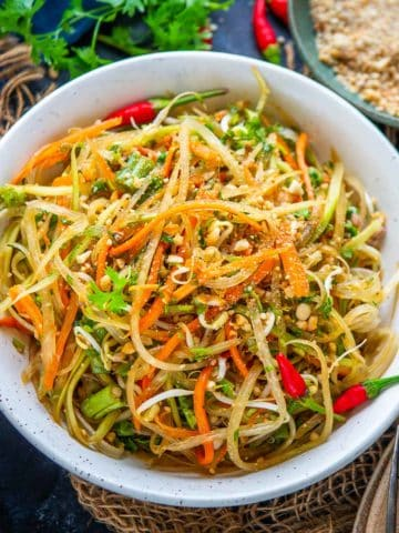 This light and refreshing Thai green papaya salad (som tam) taste just like the one you tasted at one of the restaurants in Thailand. Check out my post for lots of tips and tricks to make this in the most authentic way in your kitchen (gluten-free, can be easily made vegan).