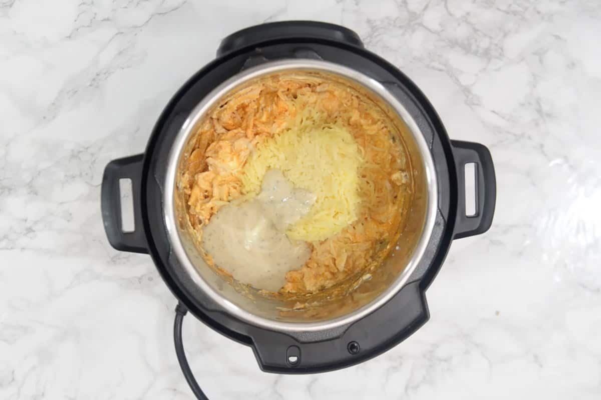 Cheddar cheese, mozzarella cheese and ranch dressing added in the pot.