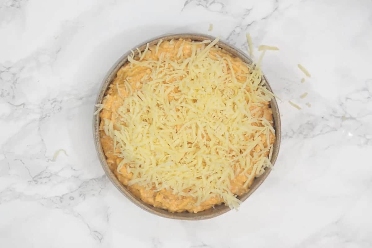 Dip transferred in an oven proof dish and topped with more cheddar cheese.