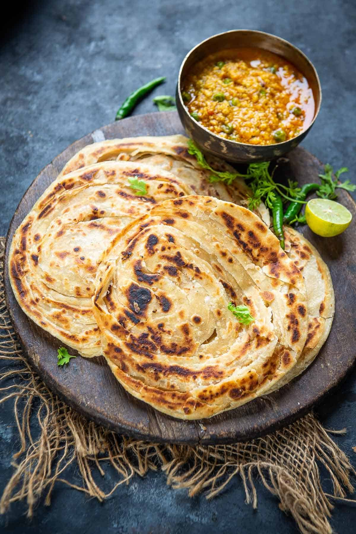 Lachha paratha served on a plate.