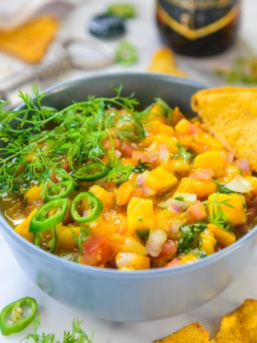 Mango habanero salsa is a quick and easy dip that you can make in under 15 minutes to serve along with crackers or chips. This homemade recipe is a family favorite and summer Friday nights are incomplete without it.
