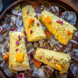 Make this rich and delicious mango kulfi at home using my traditional recipe for that authentic taste and texture. There is also a cheat's instant version shared in the post which comes together in under 10 minutes.