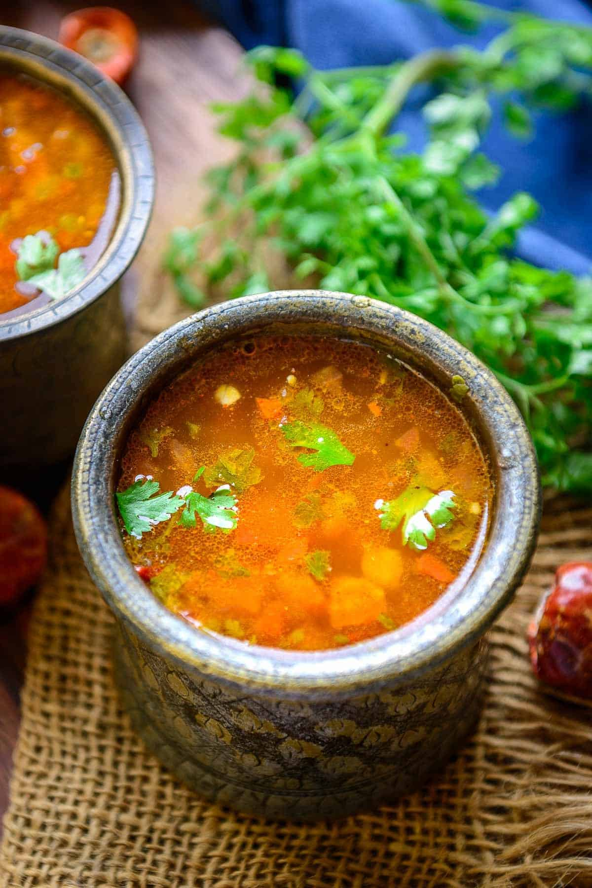 Rasam served in a bowl.