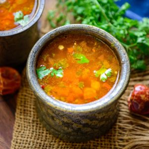 Rasam is a spicy and tangy South Indian soup or stew made using tomatoes, tamarind, and a freshly made spice mix (rasam powder). It is a staple in most South Indian households and is served with steamed rice for everyday meals. Make it using my simple recipe in under 20 minutes.